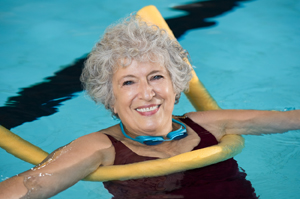 Woman exercising in a pool.